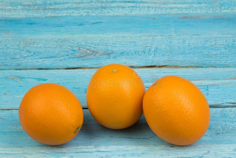 Ripe orange fresh orange, on wooden background royalty free stock photo