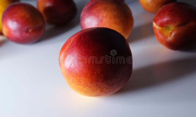 Orange nectarines on a white background. Ripe orange nectarines isolated on a white background royalty free stock images