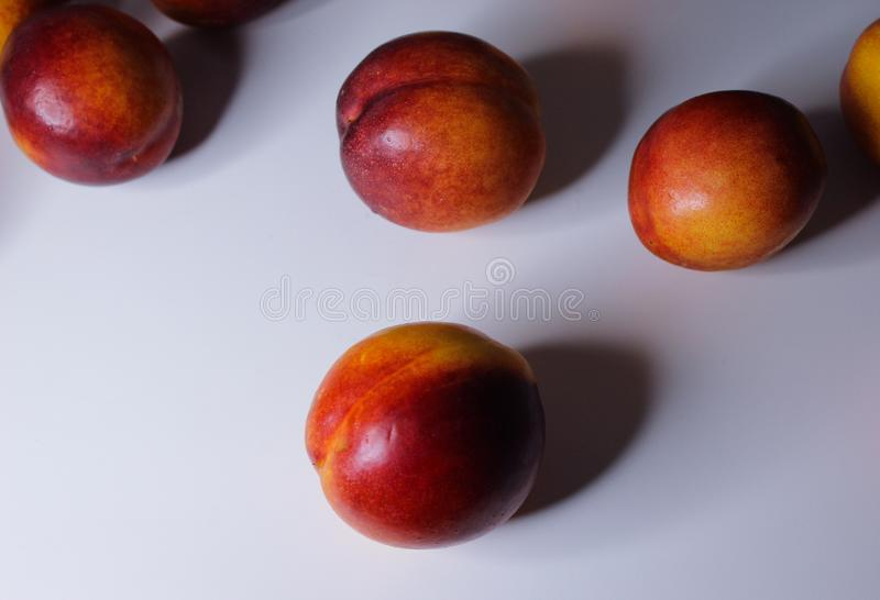 Orange nectarines on a white background. Ripe orange nectarines isolated on a white background stock images