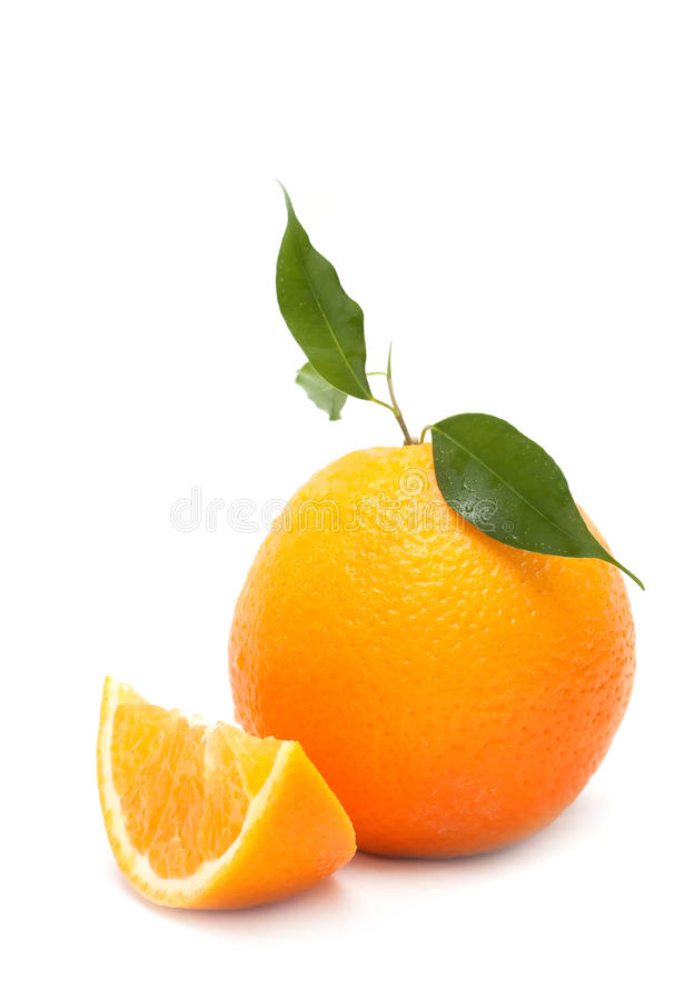 Ripe orange with a slice. On white background stock photos