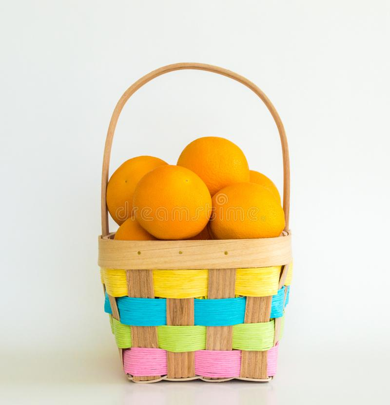 Ripe oranges in an Easter basket stock photo