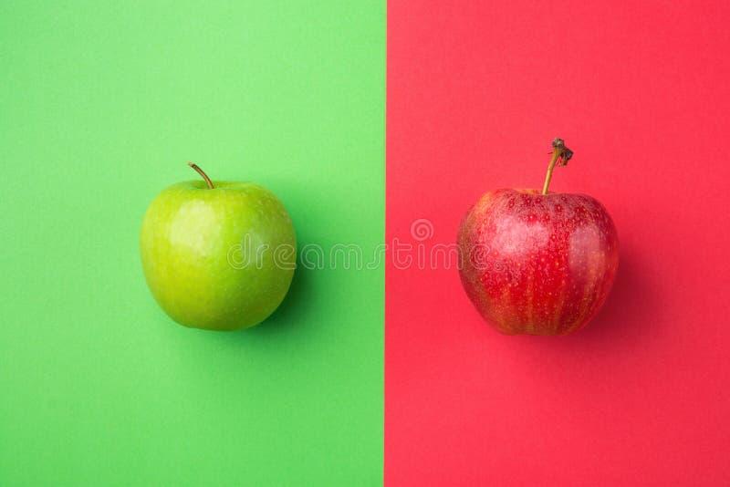 Ripe Organic Apples on Split Duotone Green Scarlet Red Background. Styled Creative Image. Vitamins Summer Vegan Fashion Concept. Ripe Organic Apples on Split stock image