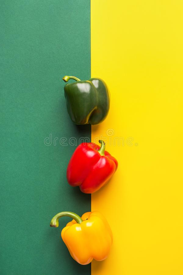 Ripe organic vegetables colorful red yellow green bell peppers on duotone background. Healthy plant based diet. Mediterranean cuisine ingredients detox concept royalty free stock image