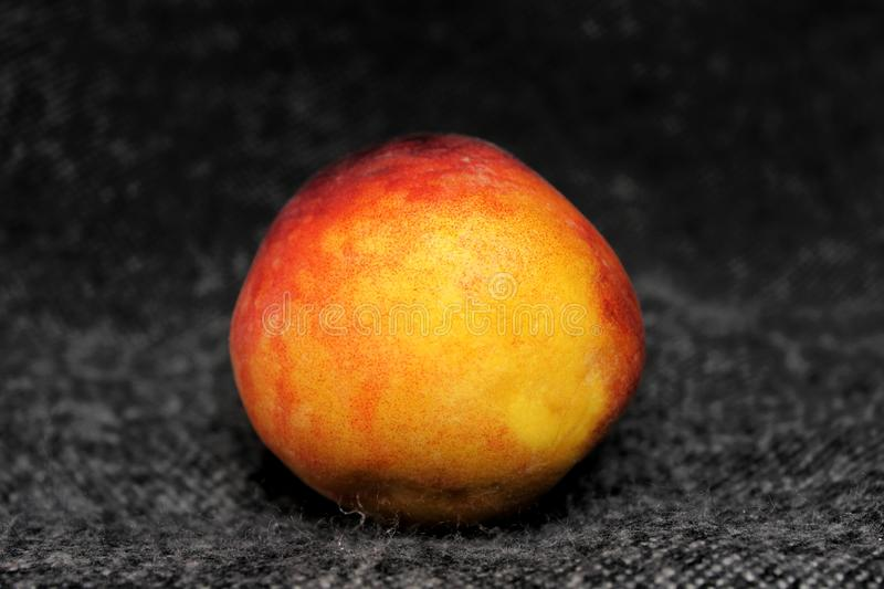 The  peach on the dark background royalty free stock images