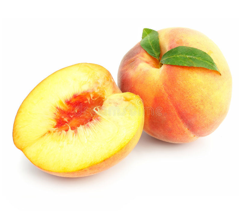 Ripe peach fruits with green leafs isolated stock photography