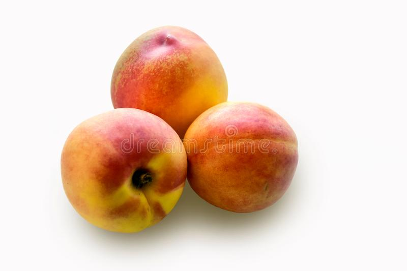 Ripe peaches isolated on white background. Ripe peaches isolated on white background on the table royalty free stock image