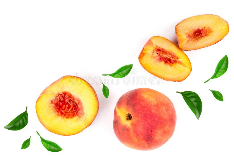 Ripe peaches with leaves isolated on white background with copy space for your text. Top view. Flat lay pattern.  royalty free stock image