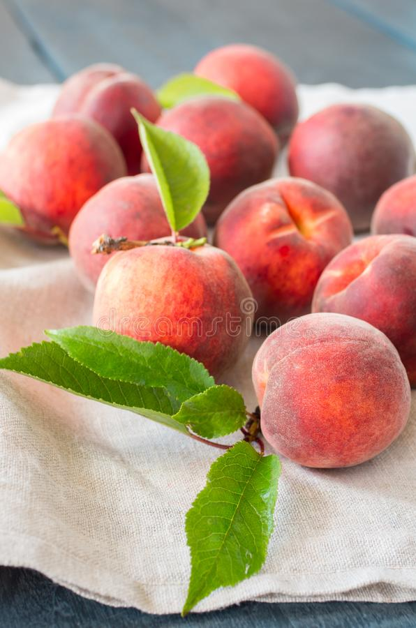 Ripe peaches on a wooden background. royalty free stock photos