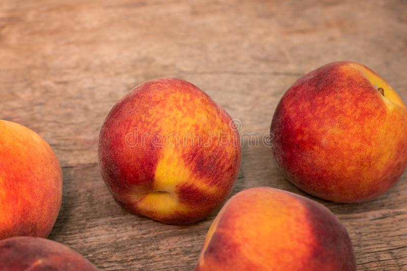 Ripe peaches on wooden background, close up royalty free stock images