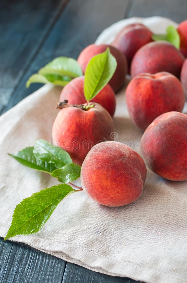 Ripe peaches on a wooden background. stock image