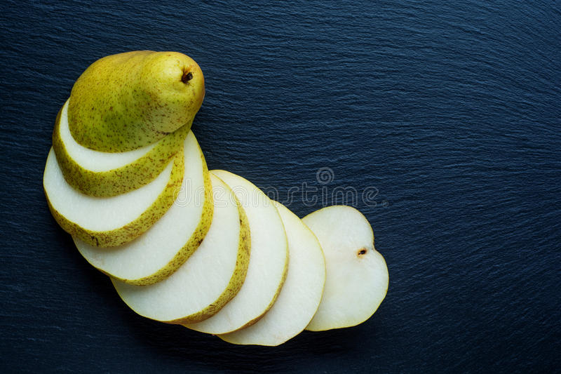 Ripe Pear on the dark slate background stock image