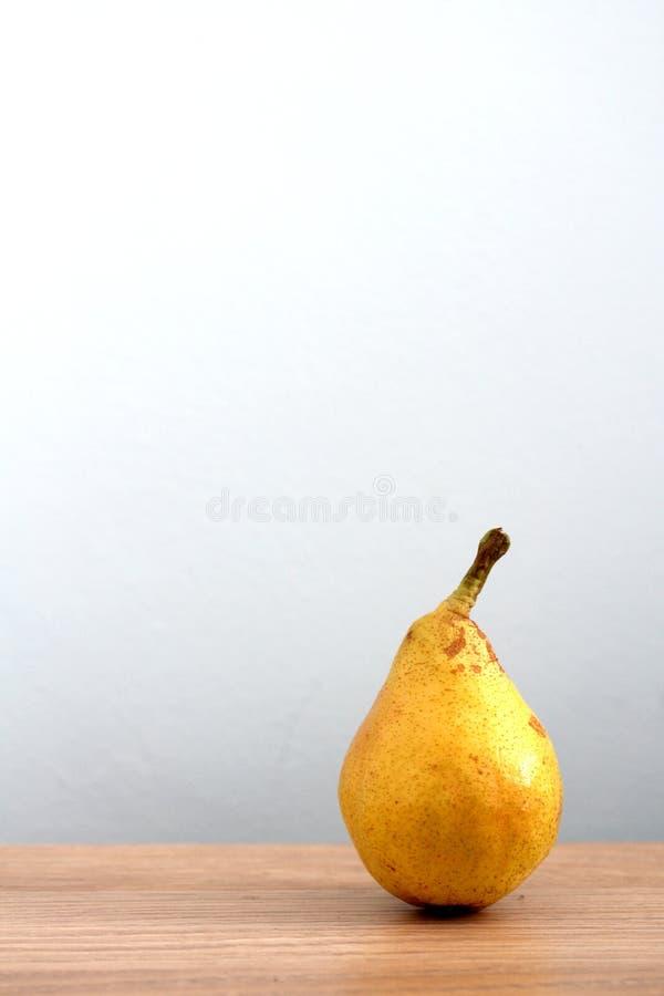 Ripe pear on desk royalty free stock photos
