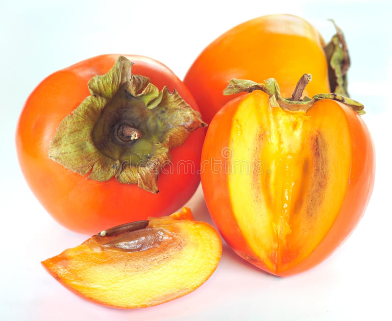 Download Ripe persimmon stock image. Image of green, leaf, white - 11742417