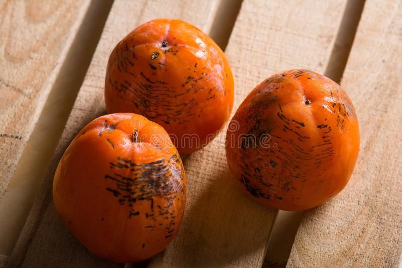 Ripe persimmon of a winter crop. The frozen persimmon of a winter crop stock photography