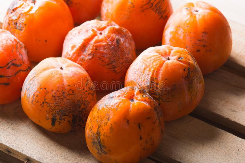Ripe persimmon of a winter crop. The frozen persimmon of a winter crop royalty free stock photography