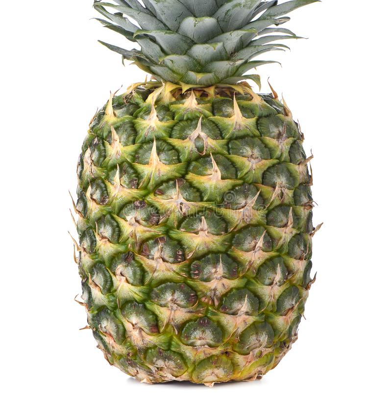 Ripe pineapple is isolated on a white background stock photo