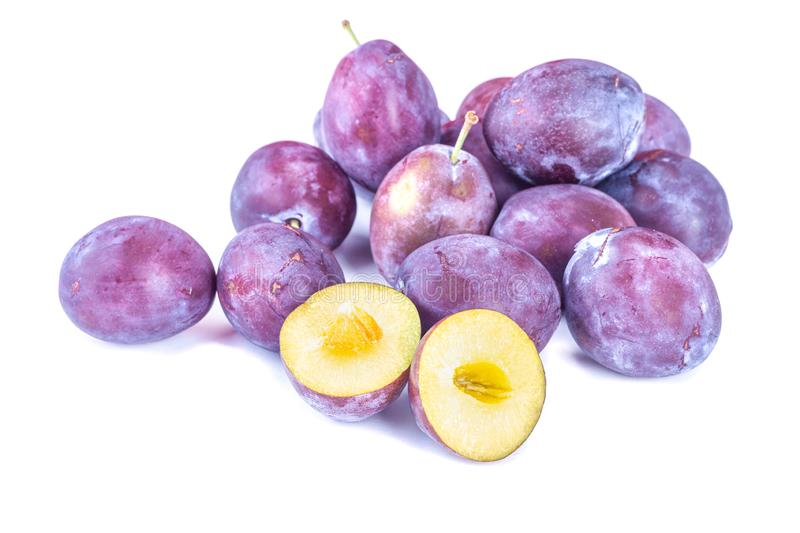 Ripe plums. Vegetarian food. Fruit for the cake. Organic fruits. Isolated with background. stock photography
