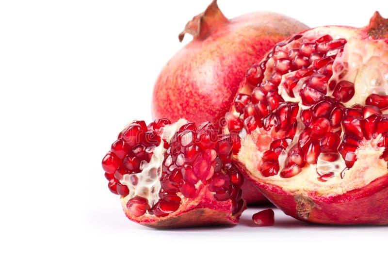 Ripe pomegranate fruit. With half isolated on white background stock photography