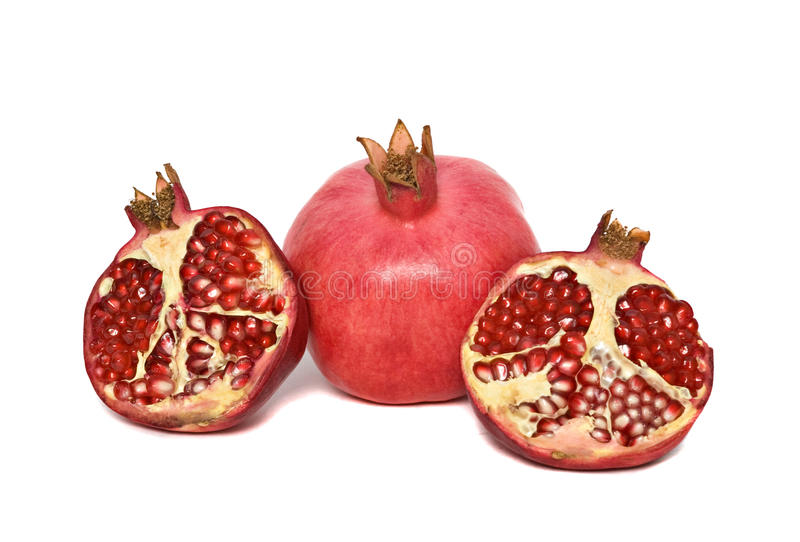 Ripe pomegranate and its sections stock photo