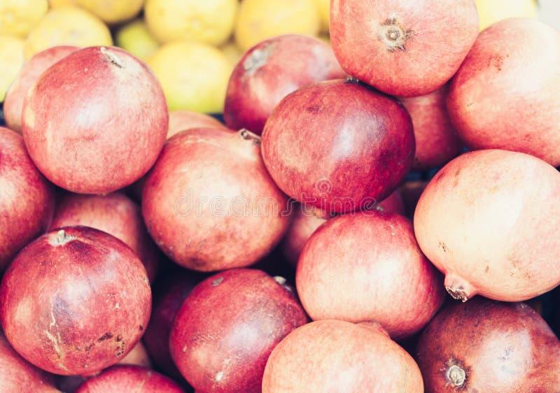 Ripe pomegranates in the fruit market, Catania, Sicily, Italy.  royalty free stock photo