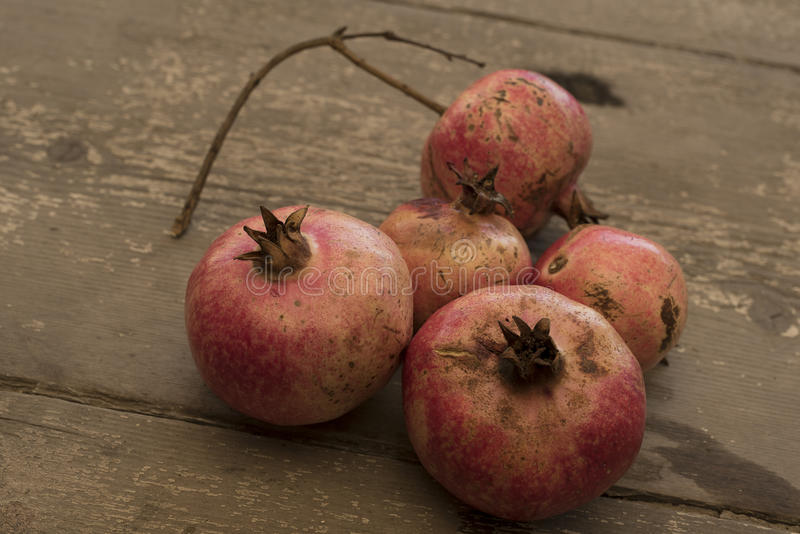 Ripe pomegranates, red, on a wooden table. stock images