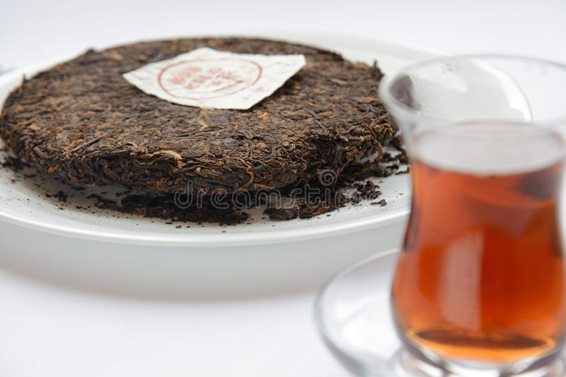 Ripe puer tea cake. On white royalty free stock images