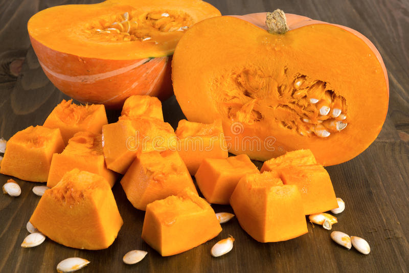Ripe pumpkin cut into pieces stock photo
