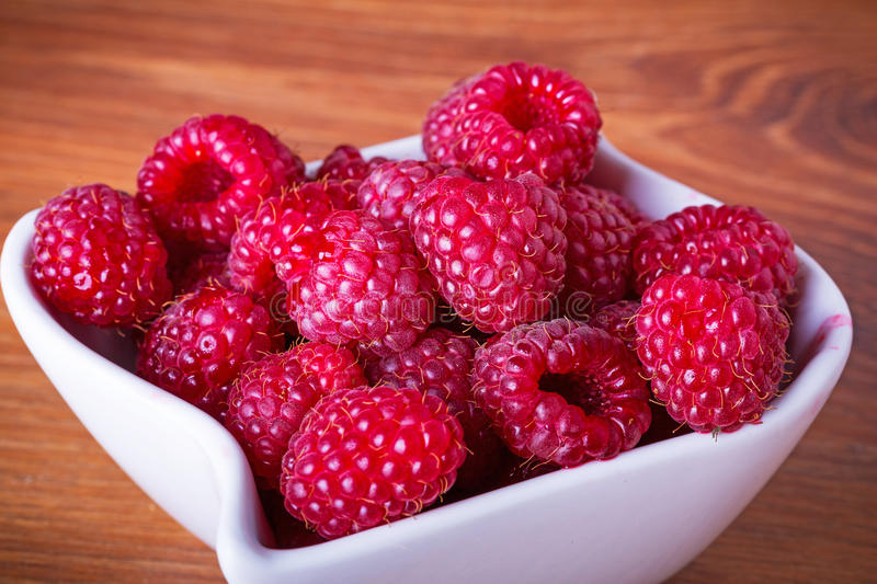 Download Ripe Raspberries In The Bowl Stock Photo - Image of kitchen, closeup: 33919992