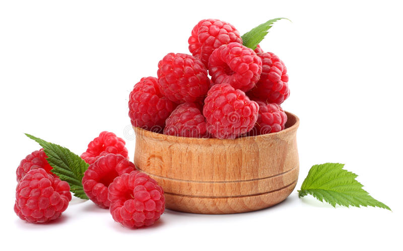Ripe raspberries with green leaf isolated on white background macro stock images