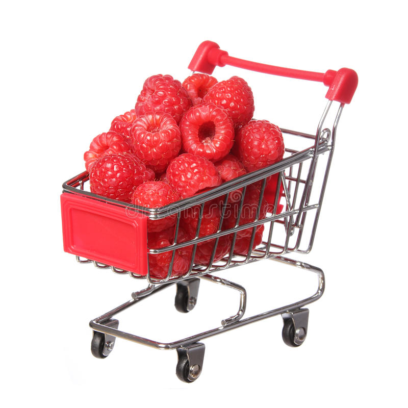 Ripe raspberries in shopping cart isolated. concept. Ripe raspberries in shopping cart isolated on white. concept royalty free stock image
