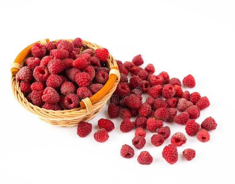 Ripe raspberries in sprinkled on a white background royalty free stock photos