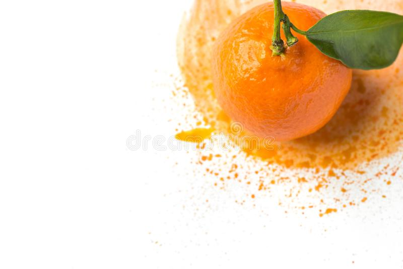 Ripe raw bright orange tangerine with stem green leaf on hand painted watercolor splashes paintbrush stroke background. On white paper. Summer fruits citrus stock photo