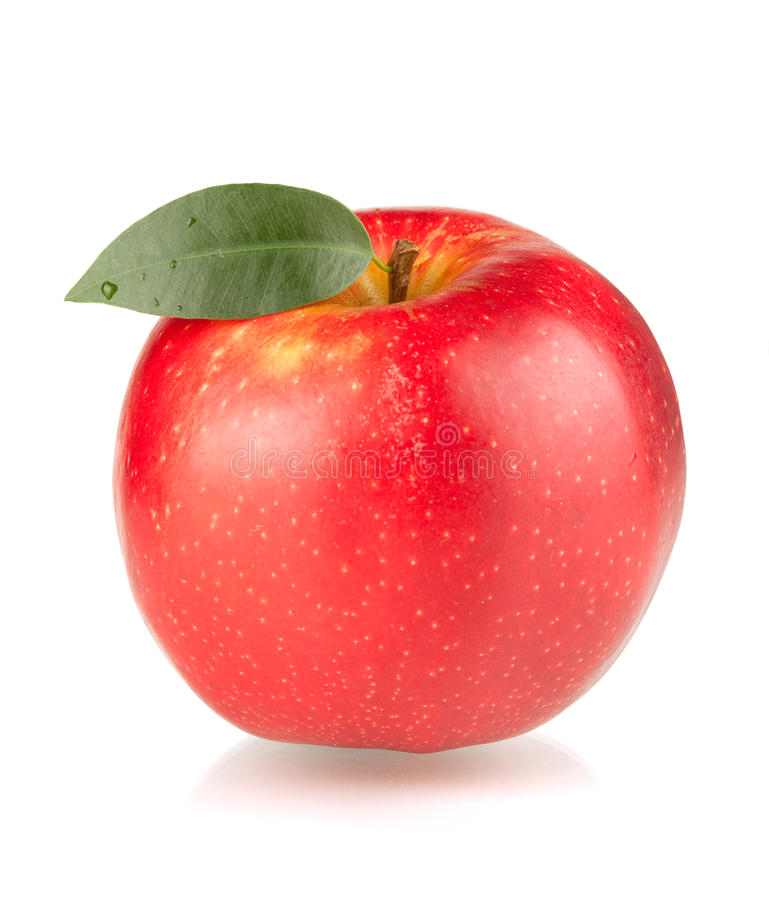 A ripe red apple with green leaf royalty free stock image