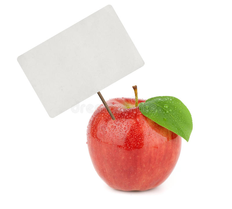 Ripe red apple with price tag stock photography