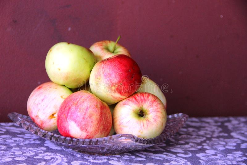 Ripe red apples and yellow apples on the table. still life many red-yellow apples on the table. Ripe red apples and yellow apples on the table. still life many stock images