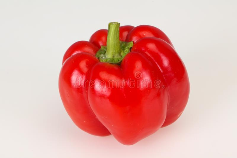 Ripe red bell pepper isolated on white stock images