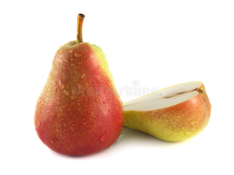 Ripe red pear with half on white (water drop) stock image