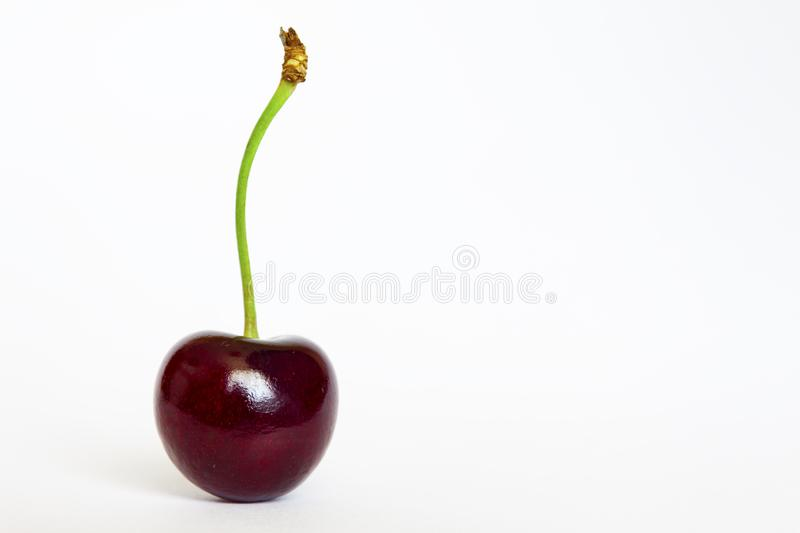 Ripe red sweet cherry, close-up on a white background, isolate stock photos