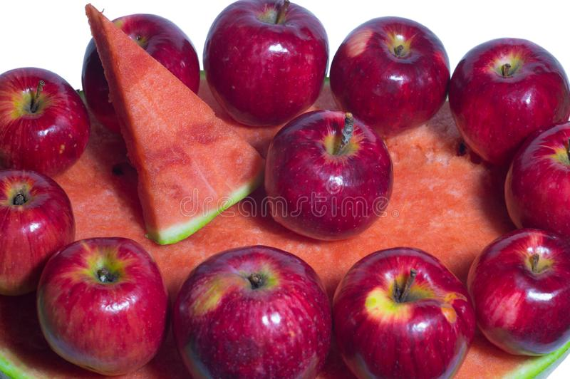 Ripe rustic red autumn apples on the background of watermelon. Fruit harvest in nature in fall season orchard royalty free stock photos