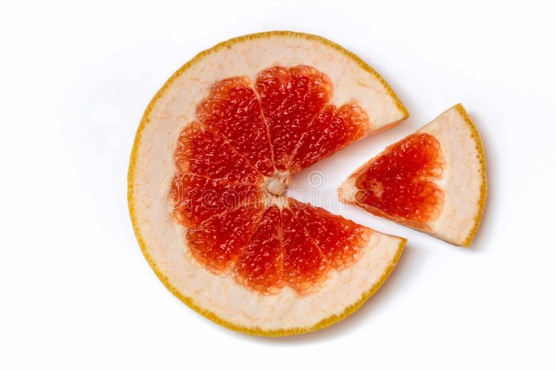 Ripe slice of red grapefruit on a white background close-up. Citrus isolated object. Cut a slice of sour fruit stock images