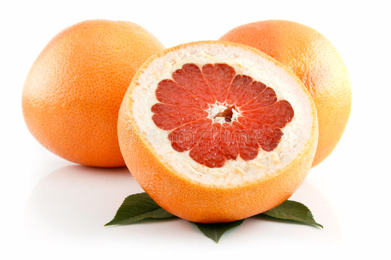 Ripe Sliced Grapefruit With Leaves Isolated Royalty Free Stock Images