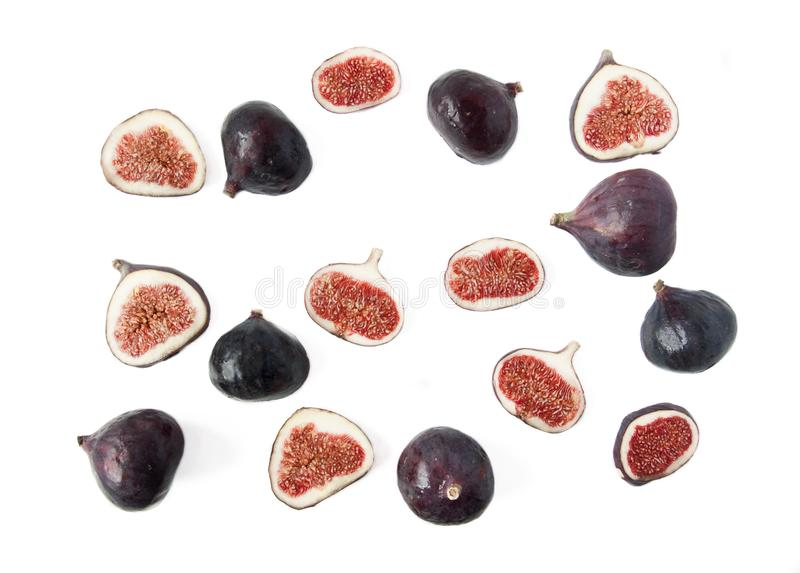 Ripe slices of figs on a light background. Grains of a fruit inside on a cut. Vitamin-rich fruit. Healthy nutrition, ingredients royalty free stock photography