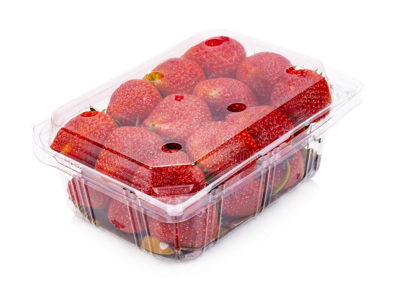 Ripe strawberries from the garden are packed in plastic boxes. Isolated royalty free stock images