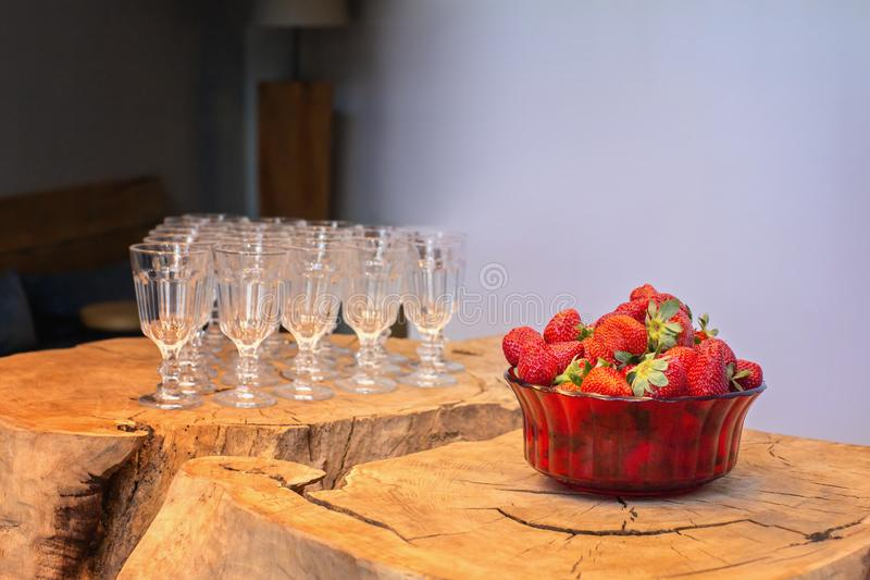 Ripe strawberries and glasses royalty free stock photos