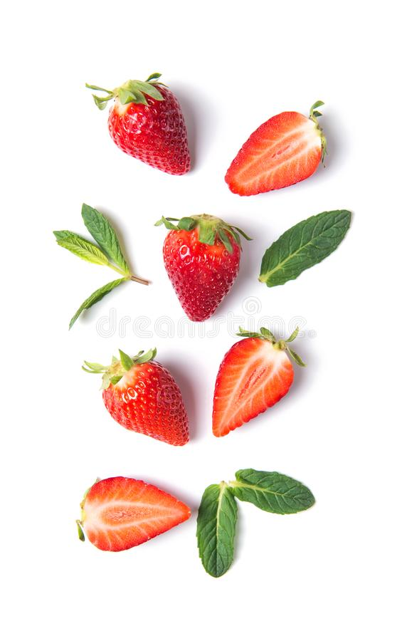 Ripe strawberries and mint leaves isolated on white background, top view royalty free stock image
