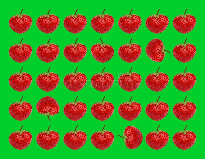 Ripe strawberries. Sweet berries strawberries on a green background. royalty free stock photos