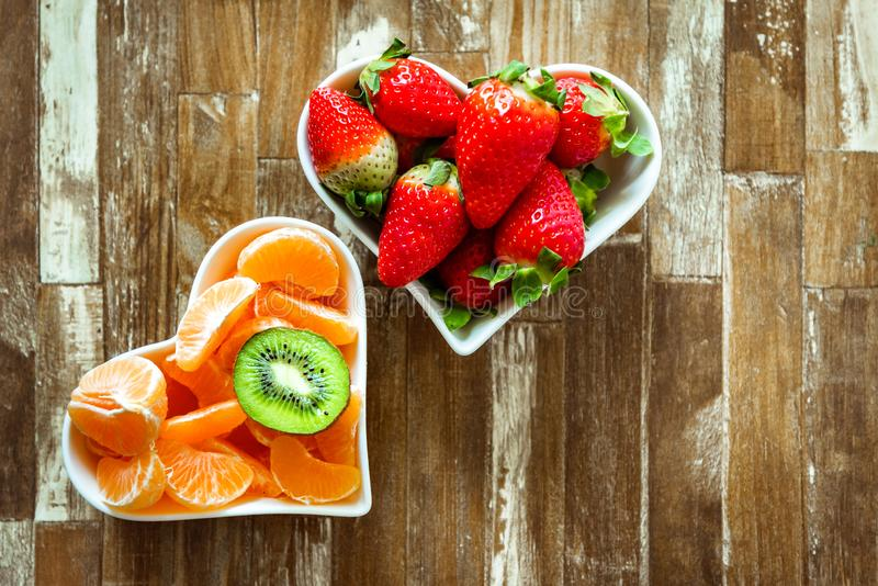 Ripe strawberries and tangerine slices royalty free stock images