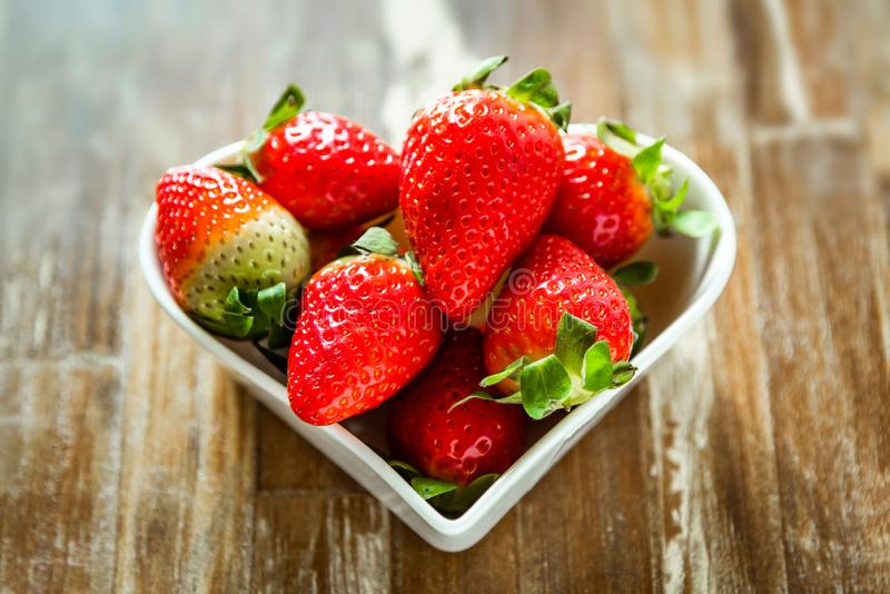 Ripe strawberries and tangerine slices stock images