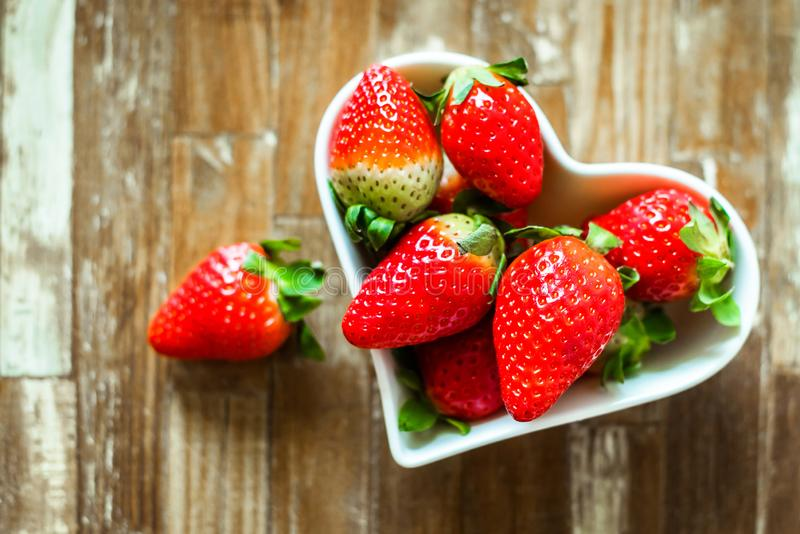 Ripe strawberries and tangerine slices royalty free stock photos