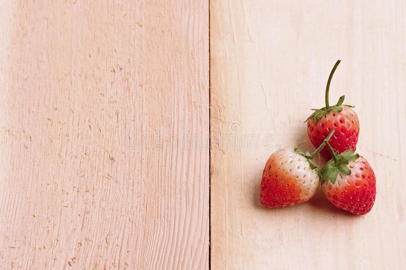Ripe strawberries. On wooden table with sweet tone stock photography